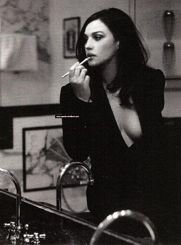 Monica Bellucci modeling / applying lipgloss. An Italian Actress and Model. Absolutely breathtaking. Brunette, Italy, Gorgeous, Stunning. Hair, Legs, Eyes, Lips = Perfection. Black and White. Photography. Fantastic.