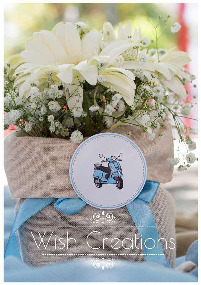 Floral centerpiece at a vespa baptism party! See more party planning ideas at CatchMyParty.com!