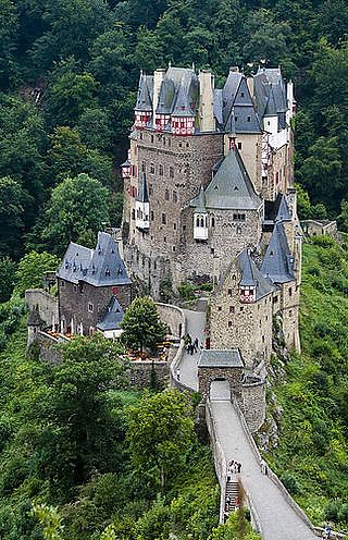 Burg Eltz, Castle started in 1157 and still in the same family.