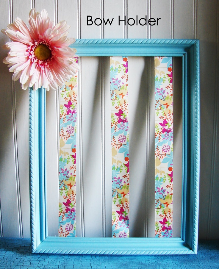I LOVE this hair bows holder.  Paint an old frame, size depending on how many bows you have.  Take strips of ribbon and staple on the back in rows.  Embellish with a large flower and clip the hair bows on the ribbons.