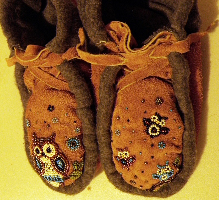 Owl moccasins that I beaded with my own design. Copper, silver, navy blue, sky blue, and ivory beads. The branches are metallic spacers.