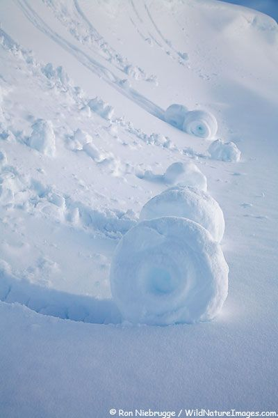 """Snow """"rolls"""" one of rarest winter phenoms are created when wet snow broke off a small cornice. Lost Lake area, Chugach National Forest, near Seward, Alaska.  REPINNED NOTE:  We have seen this at Whiteface in NY when we were skiing 2 years or so ago!  So COOL!!!!"""