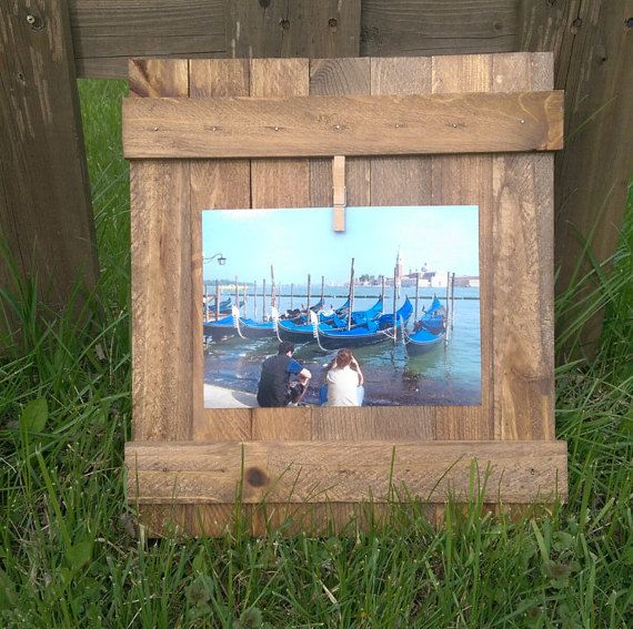 Check out this item in my Etsy shop https://www.etsy.com/listing/229590719/5x7-rustic-clothespin-picture-holder