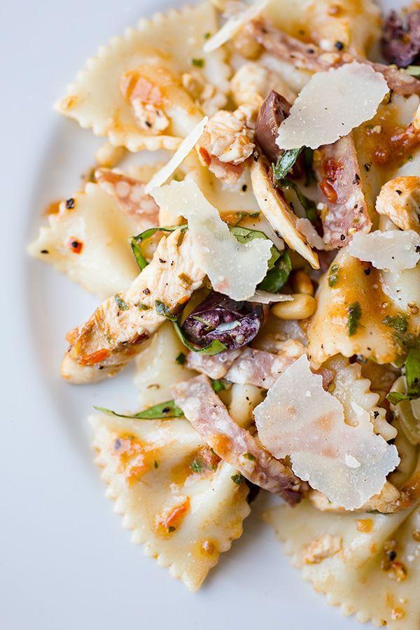 Fiery Italian Bowtie Pasta Salad with Tomato Basil Vinaigrette, Parmesan, Dry Salami, Chicken, Artichoke Hearts, and Pine Nuts...