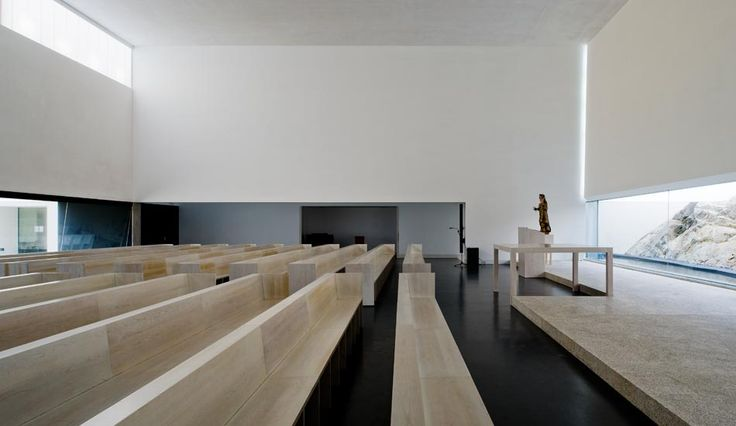 Interior of the St. Antonio's Church and Community Centre by JLCG Arquitectos.