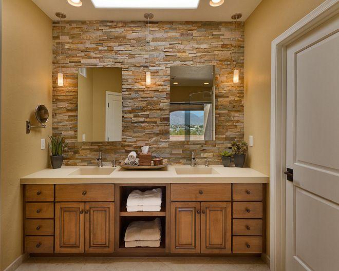 Rustic Stackstone mesh-backed quartzite backsplash, twin mirrors topped with a Caesarstone quartz counter.