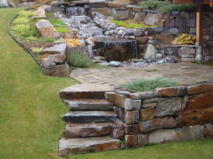 a yard with a water feature and natural stone  landscape walls  u0026 stone water feature  u00bb sbi