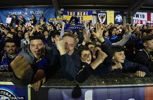 AFC Wimbledon's fans at Kingsmeadow show what the 2-0 victory means to them ...
