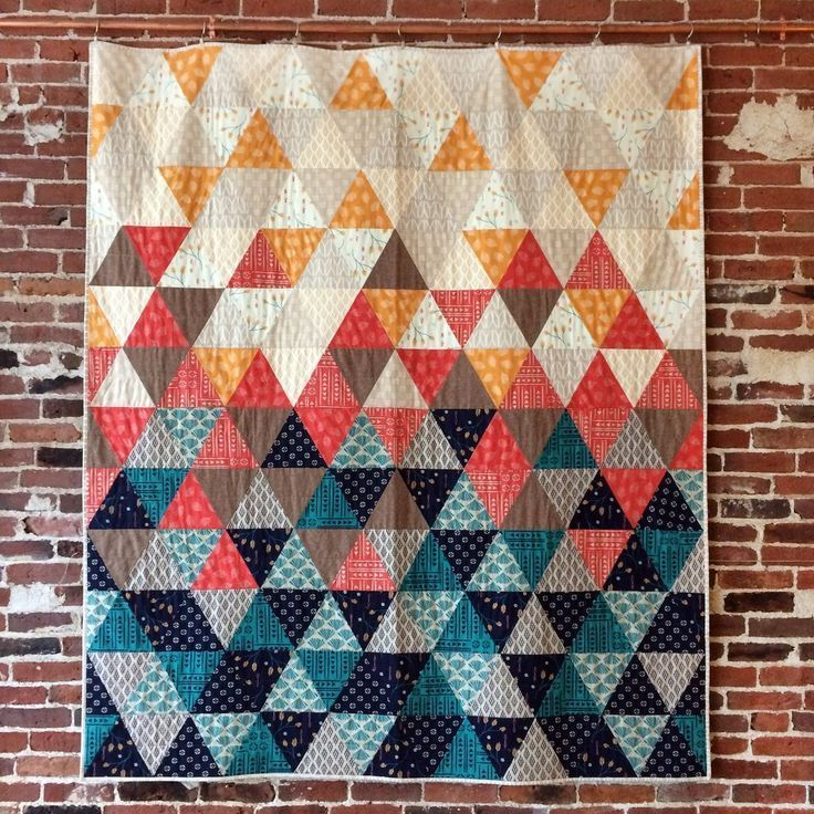 """Sew with equilateral triangles in this fun, modern quilt pattern. Cut triangles with a standard acrylic ruler or provided template. 68"""" x 78"""" Kit includes: 7 1/8 yards of fabric for top and binding -"""