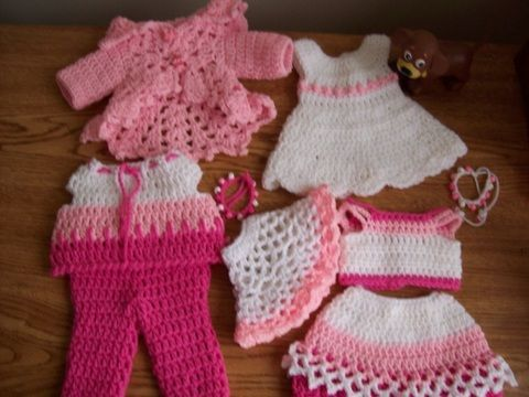 """Free crochet 18"""" doll patterns at Crochetville.com    Pretty dress, tops, skirt, pants and poncho for your 18"""" American Girl Doll. Crochetville.com"""