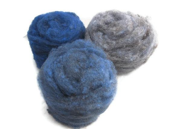 Cormo felting wool in shades of blue.