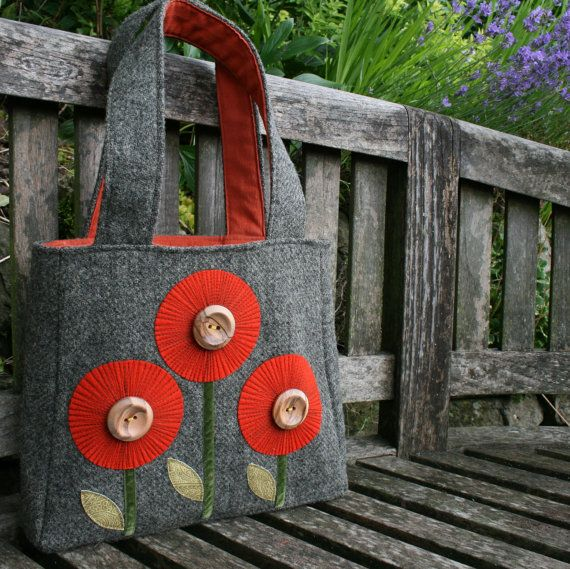 Retro handmade purse or handbag in harris tweed with orange flowers and wooden buttons.. LOVE this