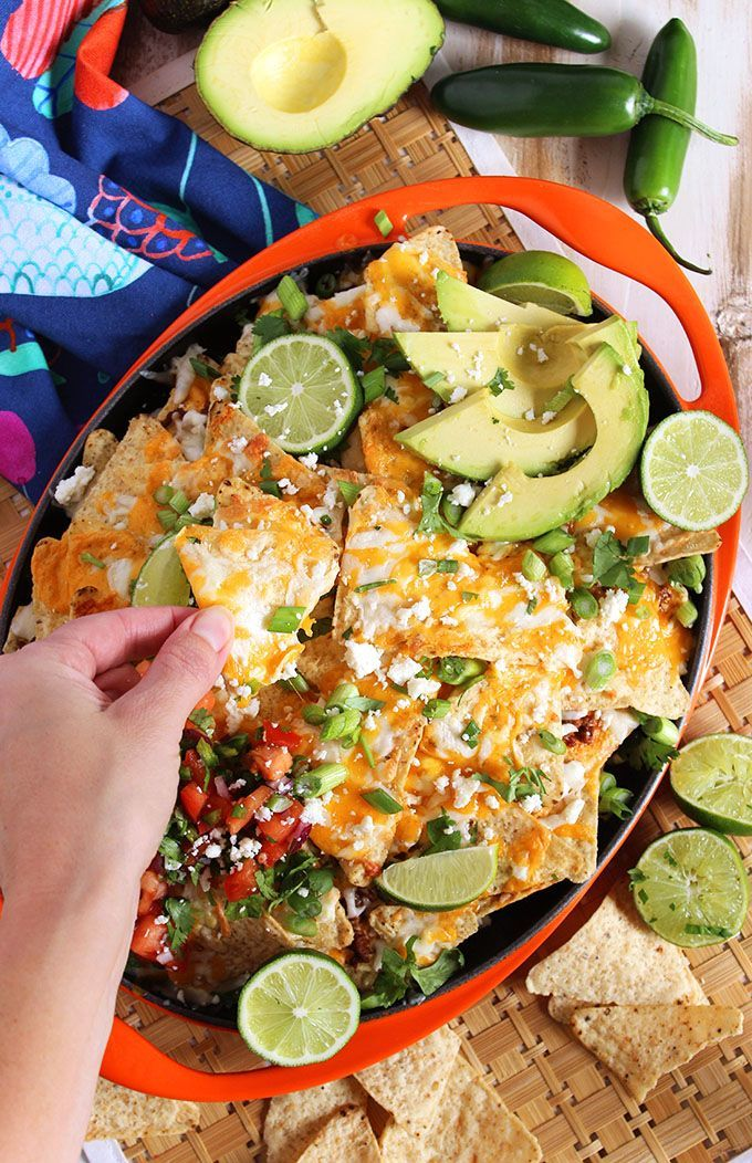 Quick and easy, the Best Loaded Beef Nachos around. Layered chips, beef and cheese topped with homemade pico de Gallo! Perfect for tailgating, Cinco de Mayo and summer parties! | @suburbansoapbox #ad