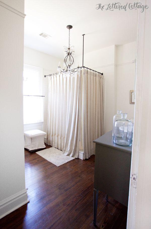 bathroom old house corner shower curtain gray vanity white walls