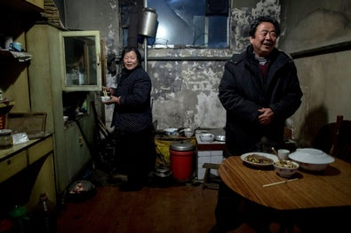 Leader's Visit Lifts a Village, Yet Lays Bare China's Woes  By ANDREW JACOBS    Jonah M. Kessel for The New York Times  HARD LIVES Gu Rongjin, Luotuowan's party chief, and his wife, Liu Demei.  Xi Jinping's visit to a particularly poverty-stricken village in north China brought it attention and help, but also threw into relief the vast scale of the challenge.
