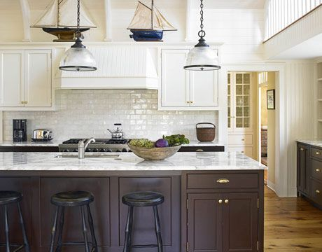 The backsplash almost has a mother-of-pearl look to it. And those pendant lights are calling my name.
