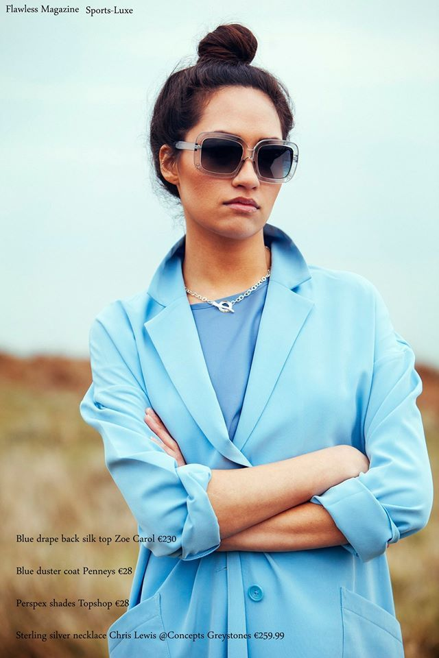 Sports-Luxe  Blue Silk Drape Back Top €230: Zoë Carol Blue Duster Coat €28: Penneys Perspex Sunglasses €28: Topshop Sterling Silver Necklace €259.99: Chris Lewis @ Concepts, Greystones  Photographer: Kyle Tunney www.kyletunneyphotography.com Stylist: Mairead Vickers www.maireadvickers.com Hair & Makeup: Orlaith Shore  Model: Dina @Flawless Model Management