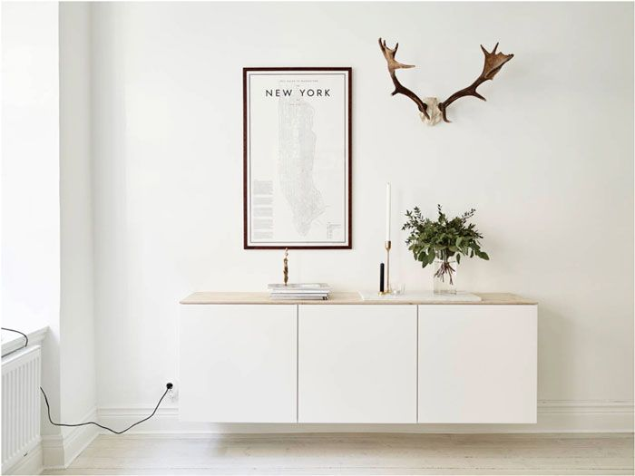 Besta cabinet from IKEA with a wood plank