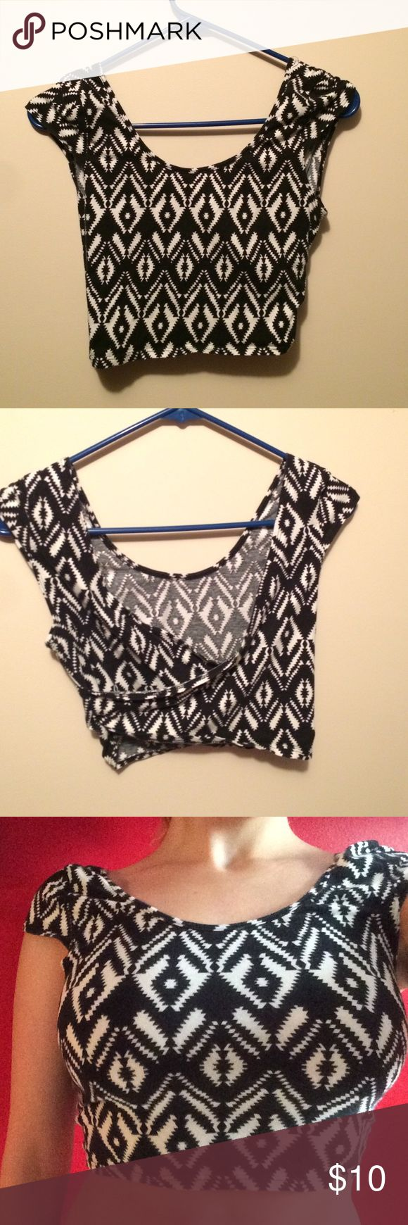 Black/white Aztec crop top with crossover back (Sorry about the unprofessionalism.) This has been worn a few times, but there's absolutely nothing wrong with it. Charlotte Russe Tops Crop Tops
