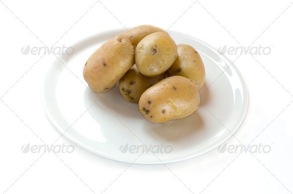 Cooked  potatoes on a plate in white background ...  agriculture, autumn, background, brown, bulbous, carbohydrate, cook, cooking, delicious, diet, farm, farming, feeling, food, fresh, green, group, harvest, health, healthy, heap, intact, isolated, meal, nature, new, nobody, nourishing, nutrition, organic, plant, potato, protein, raw, root, single, snack, spring, starch, sweet, tasty, tuber, uncooked, unpeeled, vegan, vegetable, vegetarian, vivid, white, yellow