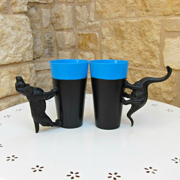 Animal Tumblers. Use toys glued (with a very strong glue) to cups