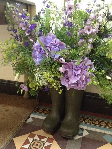 Country Garden Wedding theme - grooms wellies decorated with flowers, added a very personal touch!