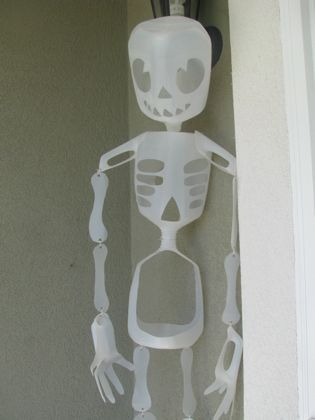 milk carton skeleton - my brother & niece made one of these for me.  I just love it!  Too cute! (And a little spooky at night.  I hang it under a tree.  The material picks up a bit of light from the street light and glows a bit.)