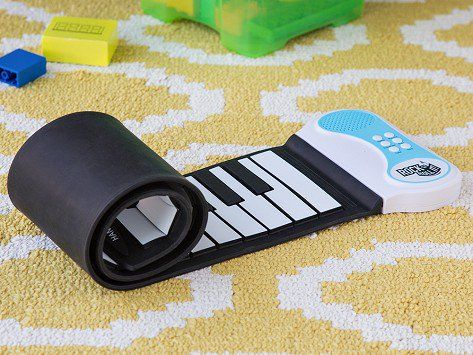 Unroll and play this portable piano anywhere. It features multiple keyboard tones and demo songs—you even have the option of record and playback for your mini masterpieces. It runs on batteries or USB so you can play when you travel, camp, or move around the house. Practice on the built-in speaker or hook it up to the sound system for a performance, then roll it up when you're done.