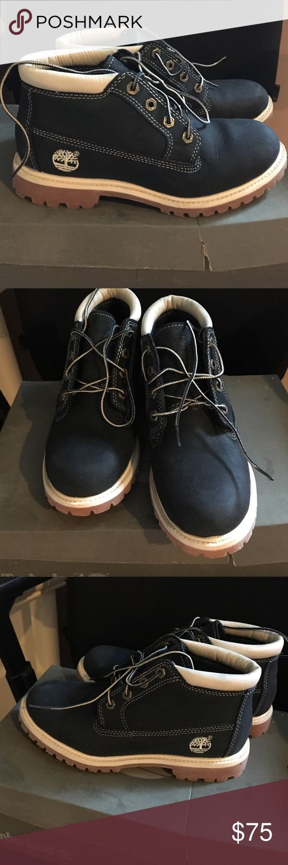 Woman's timberland boots Women's navy blue timberland boots. Water proof. Worn one time. Brand new condition. Timberland Shoes Winter & Rain Boots