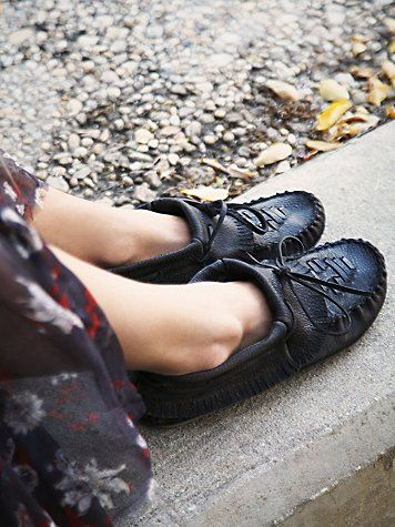 Hopewell Moccasin | Distressed leather slip-on moccasin shoe booties. Foldover cuff with baby fringe edging. *By Free People