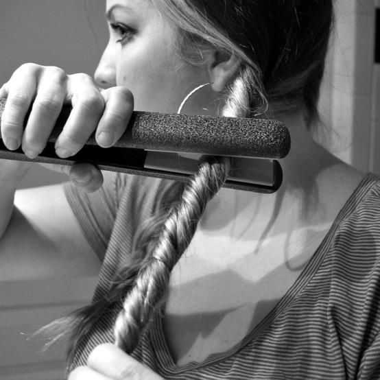 How to do beachy waves in less than 5 minutes: 1. Divide your hair into two parts. 2. Twist each section and tie with a hair tie. 3. Run your straighter/flat iron over both of the twist a few times. 4. Untie twists, and you're done. I need to try this.