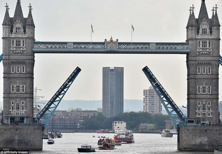 Tower Bridge was lifted in tribute to the Queen as the royal rowbarge Gloriana led a flotilla of boats down the River Thames in her honour