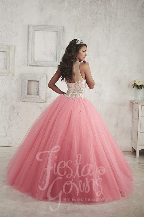 A gorgeous full tulle ball gown spangled by tiny sequins. Features a bodice covered in chunky bead work and an illusion neckline trimmed with beads. Download the Fiesta Gowns by House of Wu sizing cha