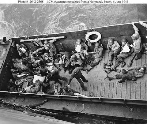 Normandy Invasion -- The D-Day Landings, 6 June 1944 :: LCM evacuates casualties from a Normandy beach. 6 June 1944 #WWII #War