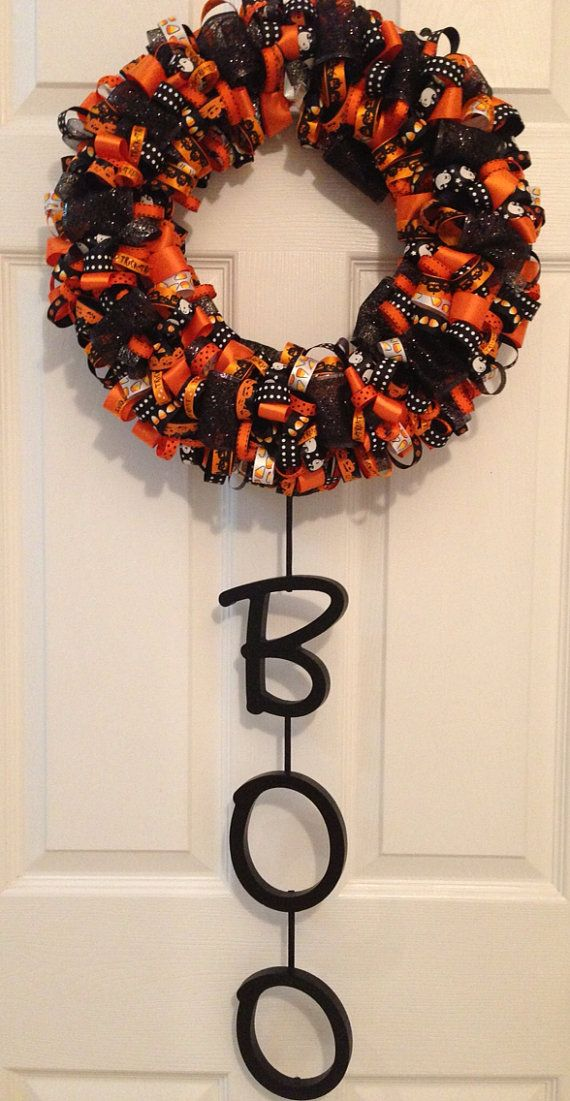 Beautiful Halloween ribbon wreath with wooden letters spelling BOO. This wreath would make a great addition to your Halloween décor. On the