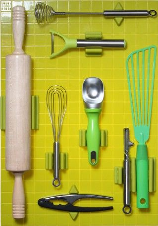 the first idea of this list of 60+ Innovative Kitchen Organization Tips ... perhaps it could be implemented inside a cabinet door as it'd get pretty dusty/gunky in Asian kitchen