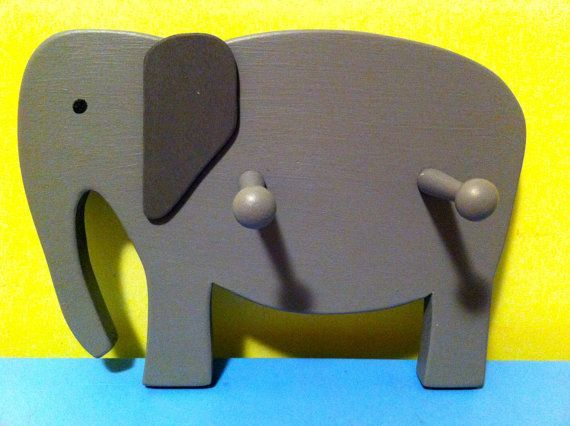 Handmade Wooden Elephant Clothes Hook made with reclaimed wood. This elephant is great for forgetful kids who leave their coats and towels lying on the floor and adults who forget where they leave their keys. Buy it now to make the memories last.