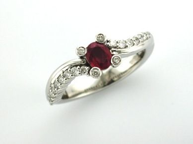 'MANILLA' --   Pretty Sweep Set Engagement Ring set with Ruby & Accent Diamonds   in 18ct White Gold    Ruby Wt. 0.35ct;       Diamond Wt. 0.20ct