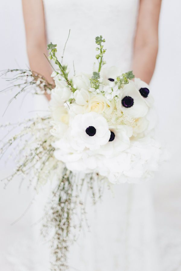 anemone bouquet, photo by Paola Colleoni http://ruffledblog.com/all-white-wedding-inspiration #weddingbouquet #flowers