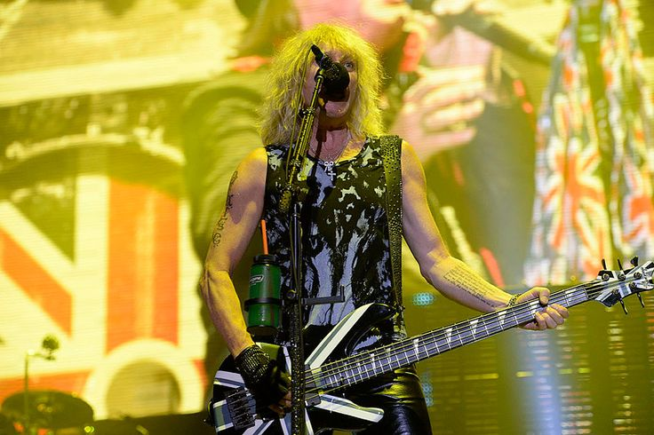 Description of . DENVER, CO - JUNE 25: Def Leppard performs June 25, 2014 at Pepsi Center as they tour with Kiss. (Photo by John Leyba/The Denver Post)