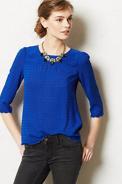 Pin dot royal blue top, chunky accent necklace, simple make-up and side bun. Done.