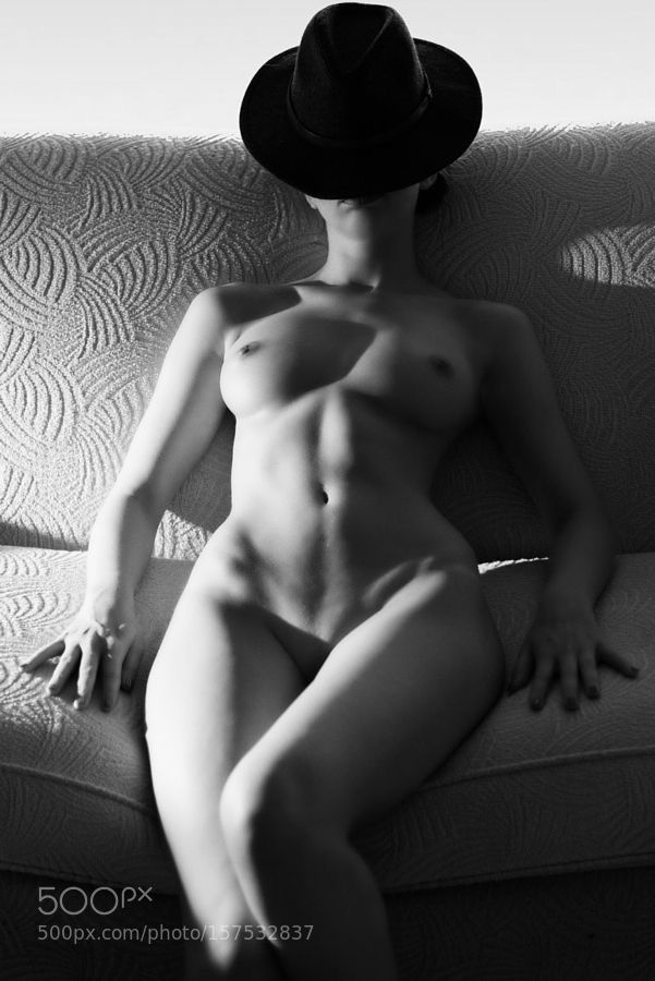 Artistic Photo Of A Naked Model In A Hat