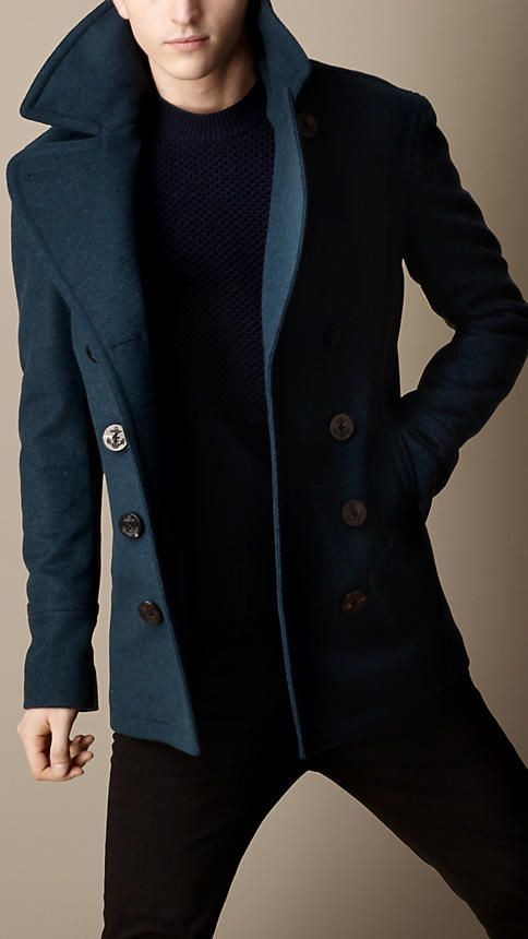 Dark blue pea coat with navy anchor buttons.