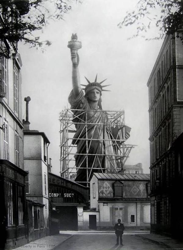 1884 photo shows Lady Liberty towering over the Paris landscape just before she was disassembled and shipped to New York. Old Photo Archive