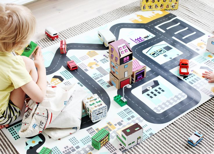 play mat with homemade buildings and cars