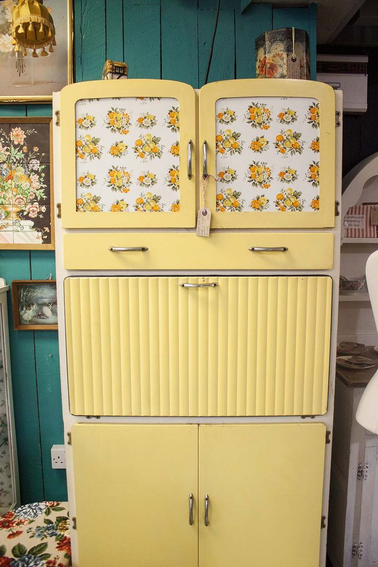 Vintage pale yellow kitchen larder cupboard. We had one when I was a child. pull down shelf/table to make a piece and jam : )