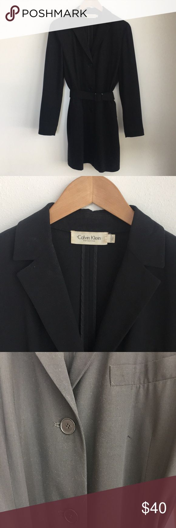 Calvin Klein Springtime Sport Coat 90's casual sports coat by Calvin Klein. Lightweight, has pocket details that are non functional. Perfect coverup for going out on a warmer night. Some wear on the corners of the belt buckle and small hole on right breast. However, it's not noticeable because there is a facing behind it. Calvin Klein Collection Jackets & Coats