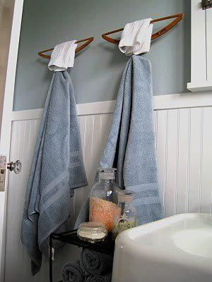 old wooden hangers make wonderful towel hangers love this idea even with the hangers upside down you could still also use them to put a shirt or dress in