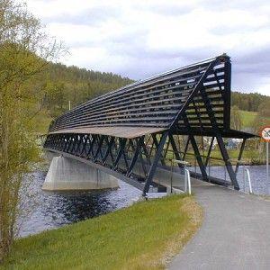 Os Footbridge is a truss bridge, pedestrian bridge (footbridge) and wooden bridge was built in 1995. The project is located in Os, Hedmark, Norway, Europe.