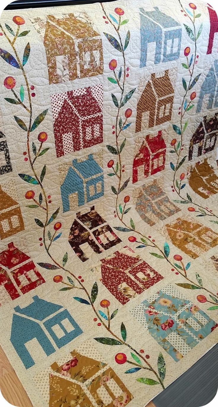 House quilt by Hamels Fabric.  Quilted with spiral leaves by QuiltNut Creations.  The Homestead quilt pattern is by Laundry Basket Quilts.